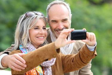 Older couple taking a selfie after Cataract Surgery